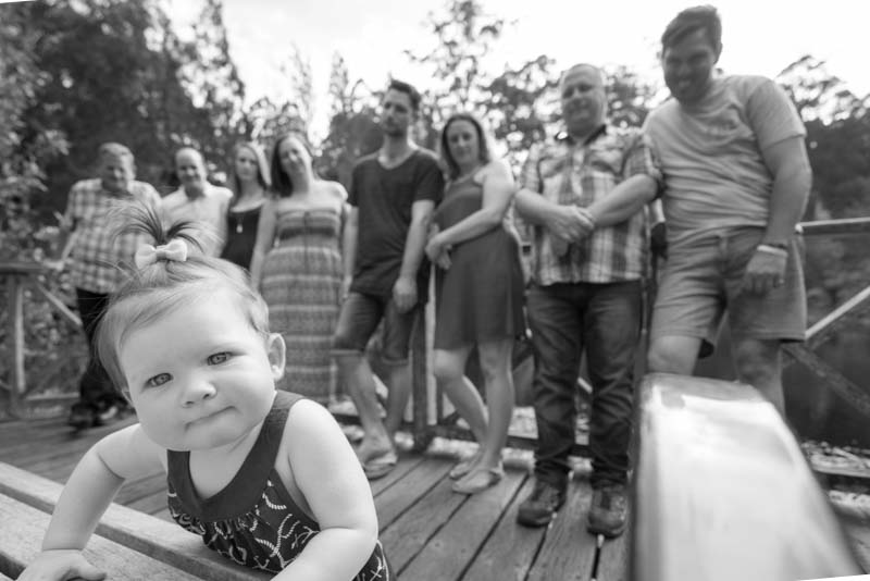 Family looking at the first granddaughter ©Erika's Way Photography