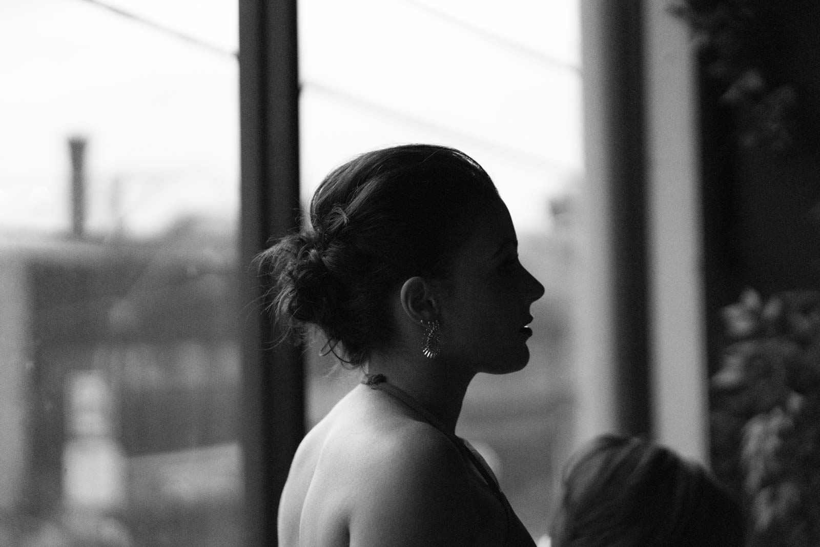 Black and white photo of a Bride, with contrasting shadows. Photo by Erika's Way Photography