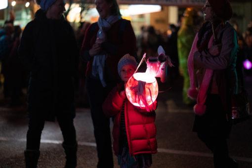 Little girl holding a pink lantern