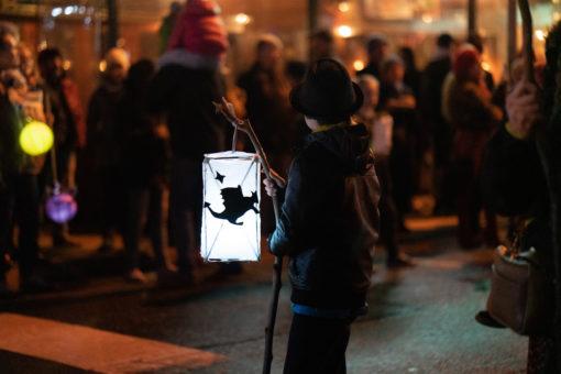 Kid holding his lantern