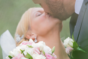 Bride and Groom kissing among the olive trees in Gippsland, Vic ©Erika's Way