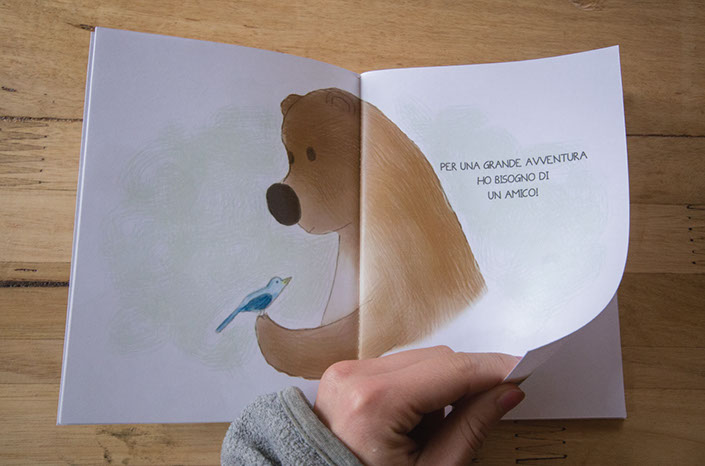 "browsing through the pages of the book ""A big adventure"", a book in Italian for English kids"