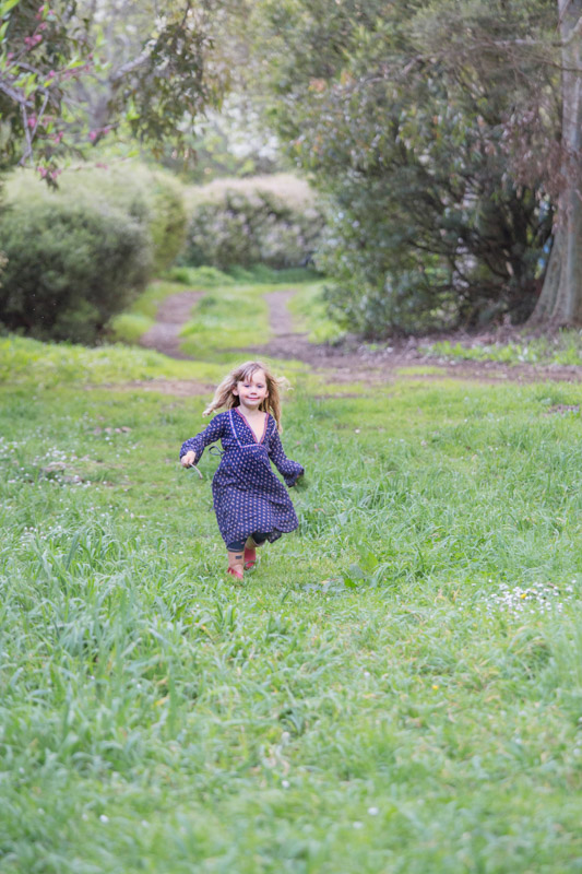 girl running in the grass. Copyright Erika's Way Photography 2015