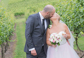 Kissing in the vineyard. Husband and Wife. © Erika's Way Wedding Photography