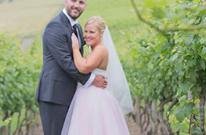 Husband and Wife in the vineyard at Wild Dog Winery © Erika's Way Photography