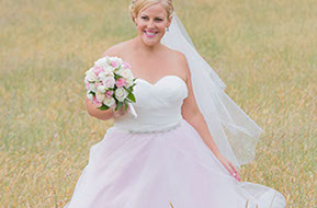 Stunning Bride in a yellow Field © Erika's Way Wedding Photography