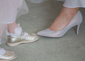 the bride's Shoes vs the flower girl's shoes. :) © Erika's Way Photography