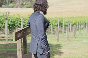 Wedding at Wild Dog Winery. Best man and the vineyard © Erika's Way Photography