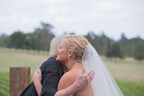 Bride and Celebrant hug © Erika's Way Photography