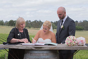 Signing the final papers. Husband and Wife at Wild Dog Winery Melbourne © Erika's Way Photography