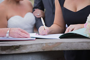 the last few signatures. © Erika's Way Wedding Photography