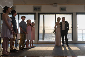 wedding ceremony at Safety Beach Sailing Club, Mornington Peninsula, Vic. The bride and the groom and their children. © Erika's Way Photography