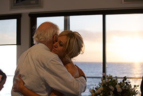 The bride and her Father hugging at Safety Beach, Mornington Peninsula, Vic. © Erika's Way Photography