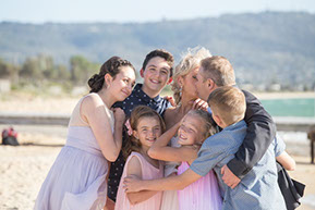 Bride and Groom and children in a big hug at the beach at Safety Beach, Mornington Peninsula, Vic. © Erika's Way Photography