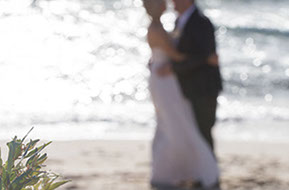 Bride and Groom at the beach. out of focus portrait © Erika's Way Photography