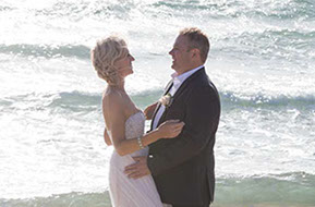 Bride and Groom and waves and sunlight at Safety Beach, Mornington Peninsula, Vic.. © Erika's Way Photography