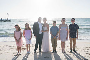 Bride and Groom and their children into the sun. Family and wedding photo shooting at Safety Beach, Mornington Peninsul© Erika's Way Photography