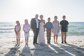 Family photo with Bride and Groom and their five children just before the wedding at Safety Beach, Mornington Peninsul © Erika's Way Photography
