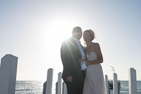 Bride and Groom into the sun at the Pier, Mornington Peninsula © Erika's Way Photography
